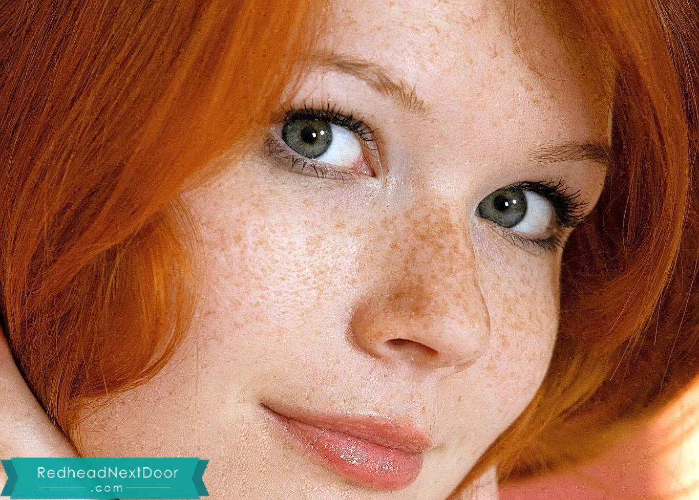 This redhead has captivating eyes of seduction - Redhead